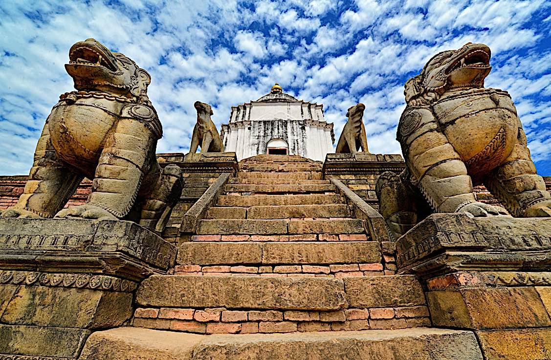 Buddha Weekly Buddhist lion statues protecting a temple in BhaktapurNepal Buddhism