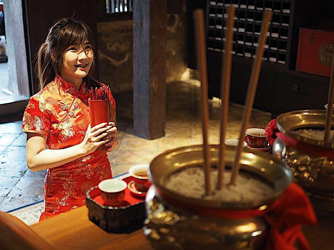 Buddha Weekly Buddhist using bamboo Chien Tung sticks at Chinese New Year in Buddhist Temple Buddhism