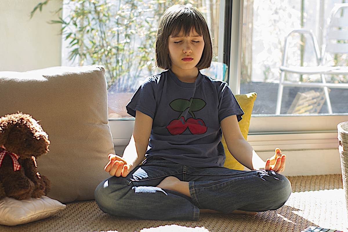 Buddha Weekly Child meditating during lockdown Buddhism