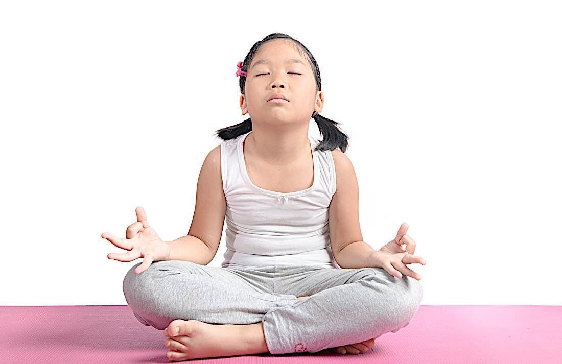 Buddha Weekly Child meditating eyes closed Buddhism