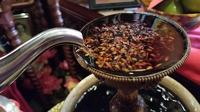 Buddha Weekly Close up Tea offering Golden Serkyem Buddhism