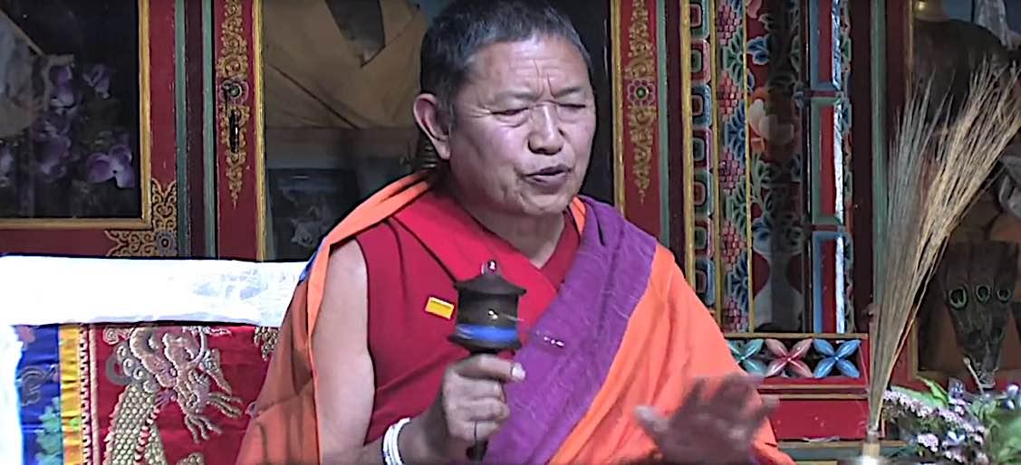 Buddha Weekly Garchen Rinpoche with prayerwheel chanting mantras Buddhism