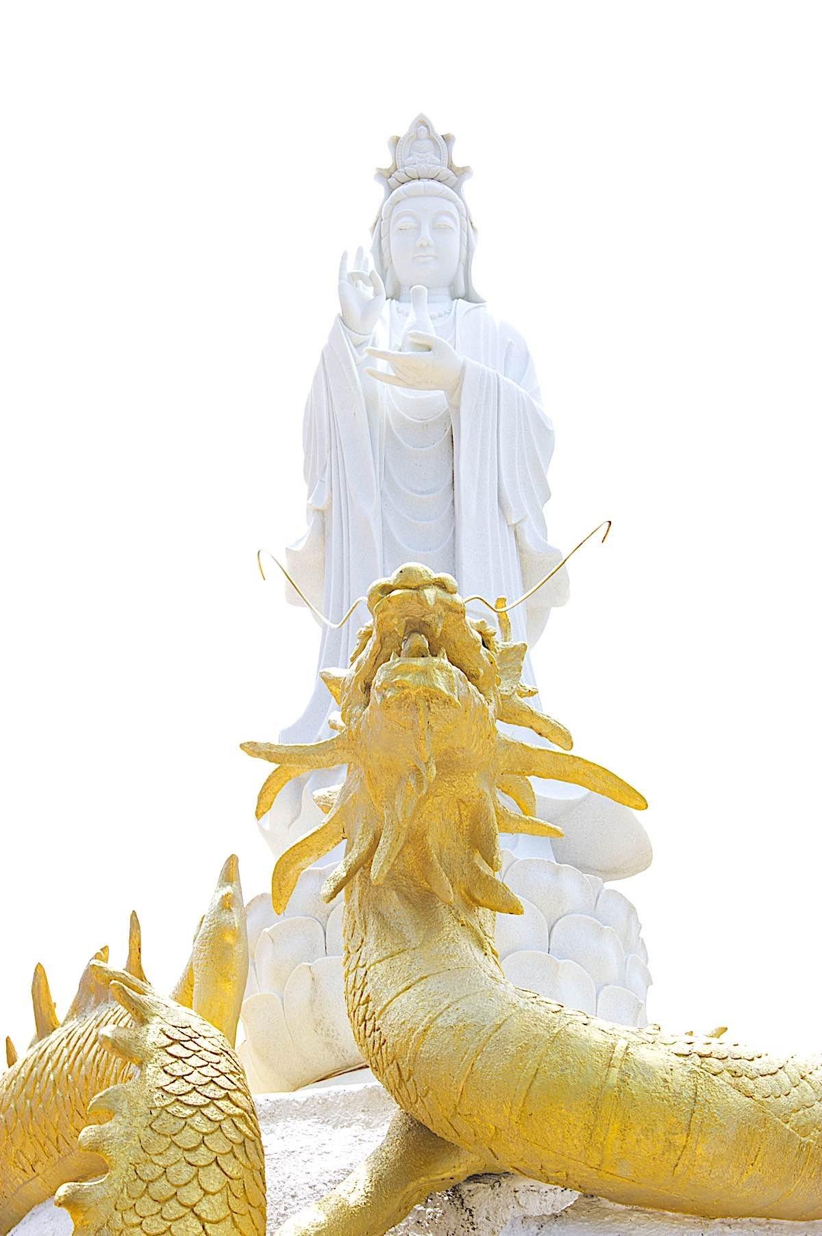 Buddha Weekly Guan Yin standing on immortal dragon dreamstime xxl 21029500 Buddhism
