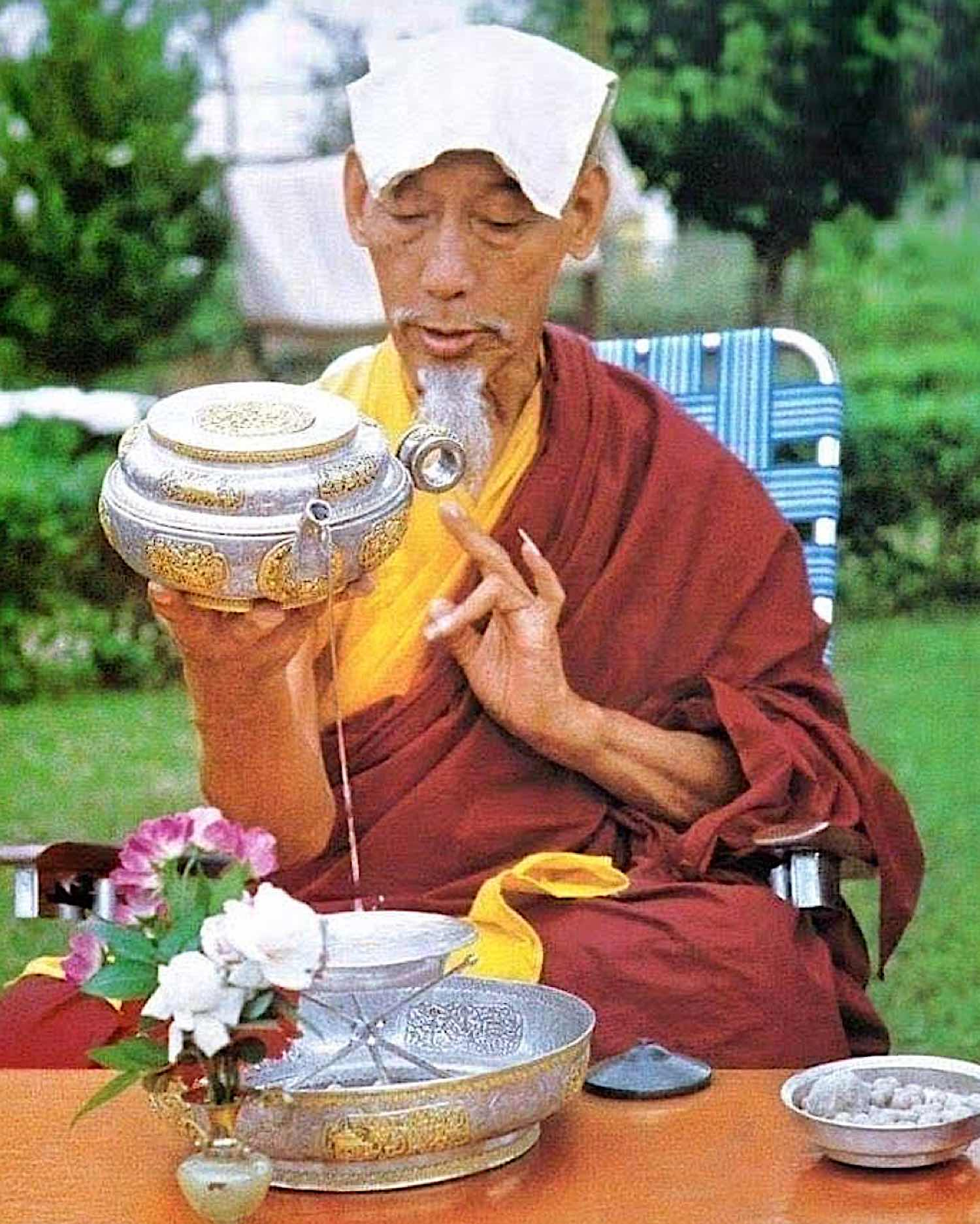 The highly respected Gelug master, Tulku Drakpa Gyaltsen, (1619-1657) — an incarnation of Manjushri and Mahasiddha Virupa — advised that we should all practise the sadhanas of Vajrapani, Hayagriva and King Garuda and make offerings to the Nagas. The Naga offerings are important because our world is suffering through ignorance, greed, politics and lack of respect for the environment. We make offering to the Nagas to help to heal our water systems which are contaminated; we all suffer from long droughts, abnormal rainfall, and a shortage of good water. There are all kinds of climate problems and the world weather patterns are changing rapidly. Who are the Nagas? According to Sutras and Shastras Nagas are classified as beings of the animal realm. For most Nagas, the upper half of the body is human and the lower half is like a serpent or fish. They have beautiful human faces and wear jewelled crowns and beautiful ornaments such as earrings, necklaces and so on. Male Nagas can be powerful and handsome looking and female Nagas are beautiful and attractive. Some N agas possess great powers , similar to the gods. The Naga realm is said to be under the oceans and seas. As well, Nagas can live in lakes, rivers springs, creeks, or marshland. Nagas also reside in trees called Naga trees. According to the famous Tibetan scholar, Dungkar Losang Thinley Rinpoche's encyclopedia, most of the Nagas are wealthy. They wear most expensive jewels and ornaments and silk scarves; they have a good life. The Nagas are divided into different classes and have various kings and queens and chieftains. There are eight great Nagas: Blue Thaye sits in the east; Red Jokpo sits in the south; Green Tob Gyu sits in the West; multi-coloured Rigden sits in the north; Norgye sits in the southeast, Pedma sits in the northwest, Dung Kyung sits in the southwest, and Varuna sits in the northeast. Many Nagas are very intelligent and they are able to practise Dharma , some have obtained Dharma realizations. Som