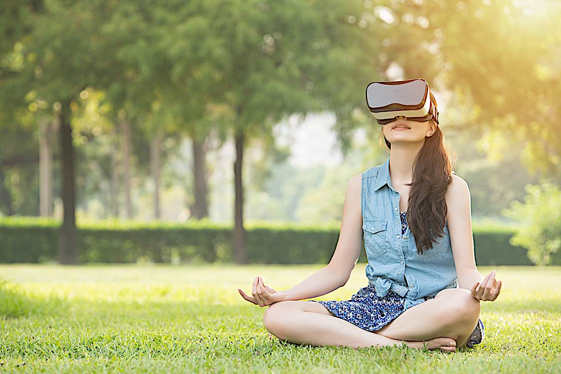 Buddha Weekly Meditating in nature with virtual reality headset Buddhism