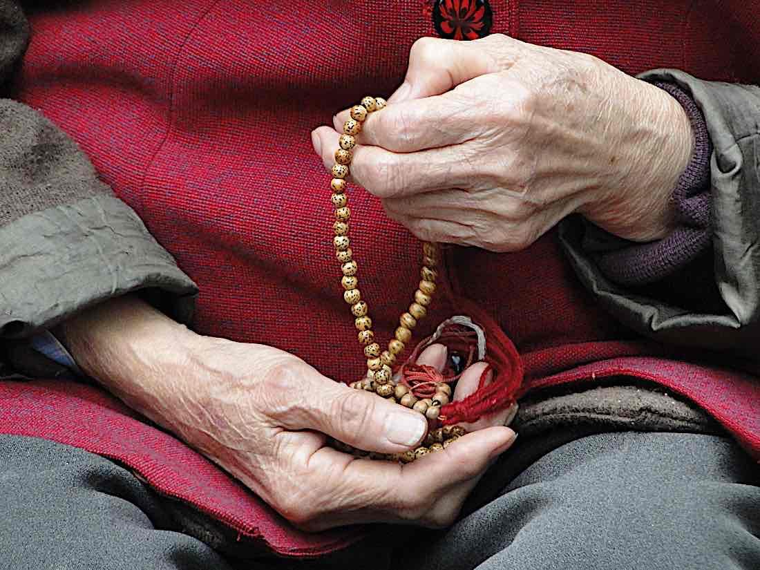 Buddha Weekly Meditation older lady hands mala Buddhism