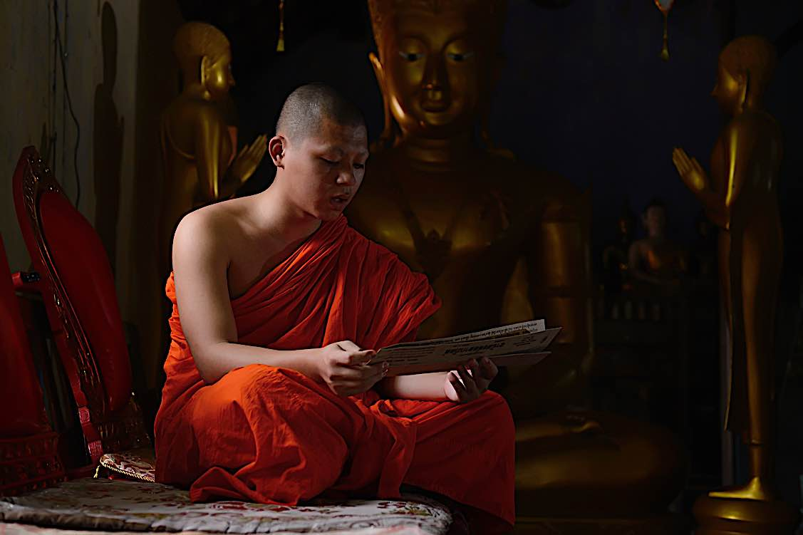 Buddha Weekly Monk chanting mantras in the morning at temple Buddhism