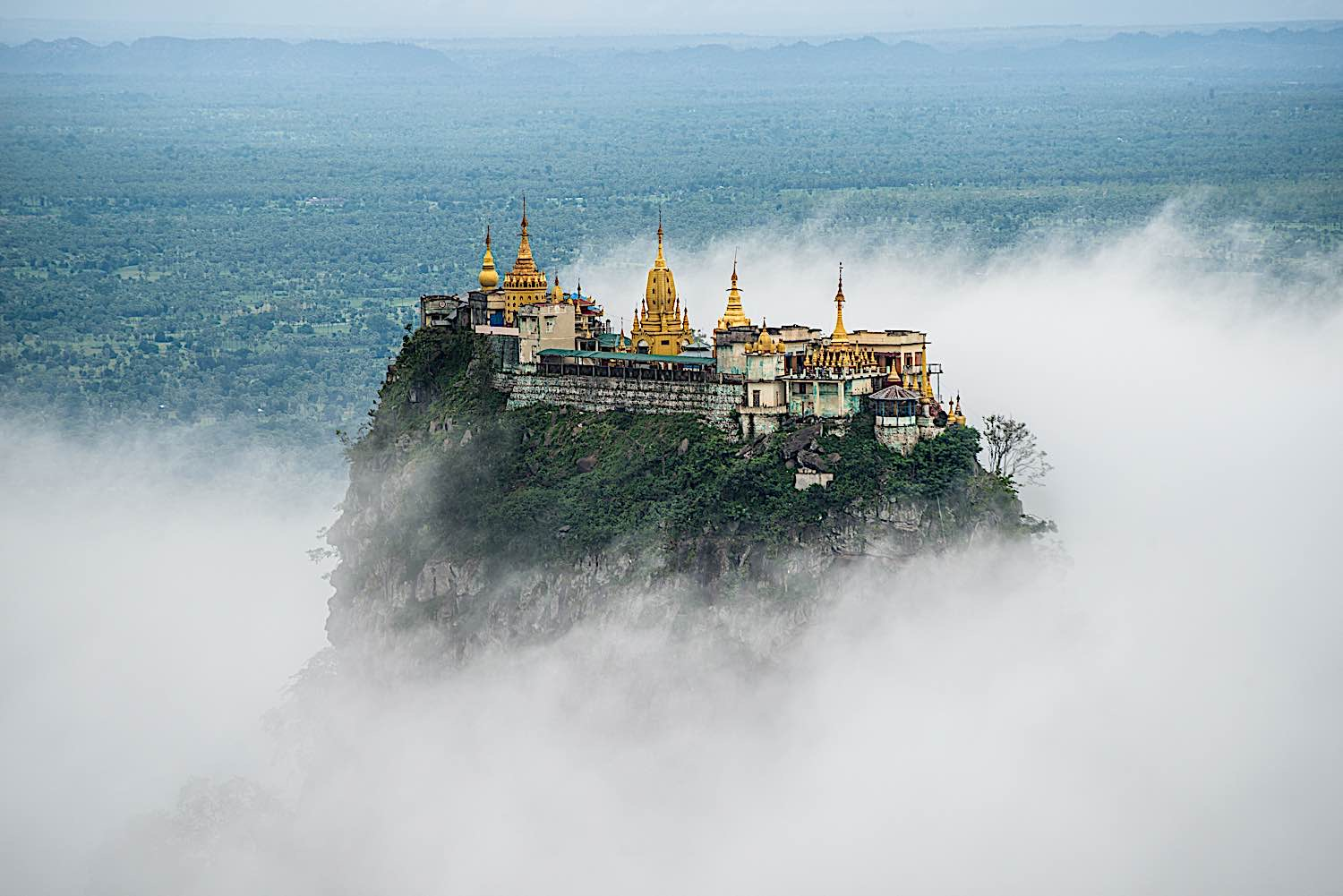 Buddha Weekly Mount Popa with fog the old volcano in Myanmar home of the Nat Burma Ghost Buddhism
