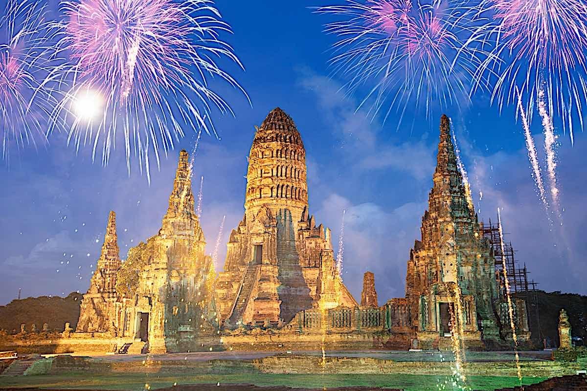 Buddha Weekly New Year Celebrating the New Year in Thailand with fireworks at Wat Chai Watthanaram Buddhist temple Thailand Buddhism