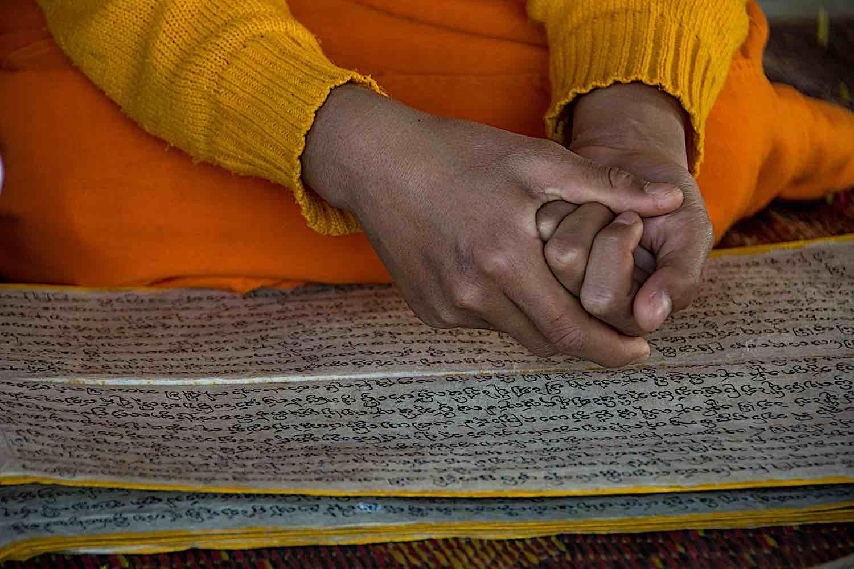 Buddha Weekly Novice monk reading Sanskrit in Laos temple dreamstime xxl 73695741 Buddhism