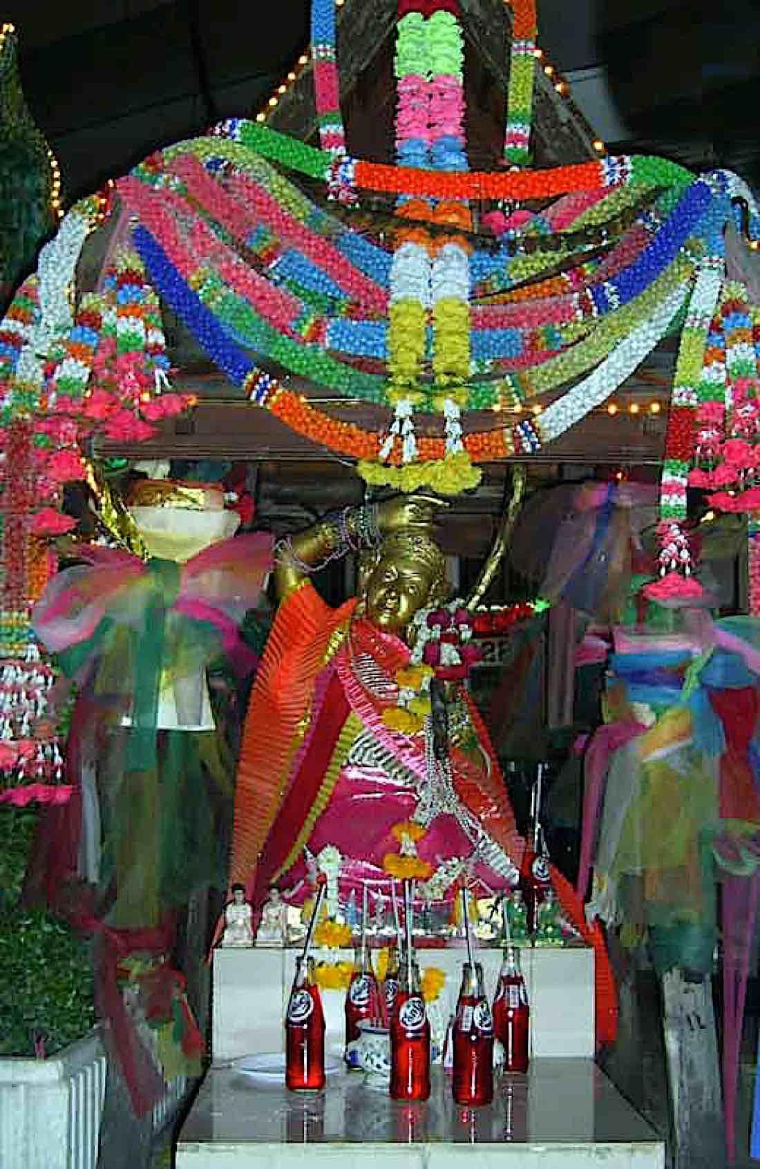 Buddha Weekly Street altar to Earth Goddess in Bangkok Buddhism