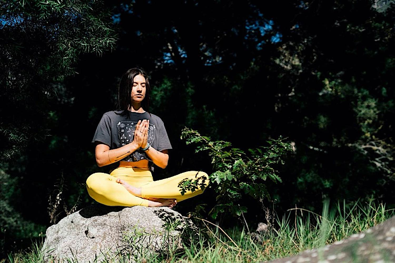 A student meditating. Research indicates meditation has numerous academic, intelligence and health benefits for students.