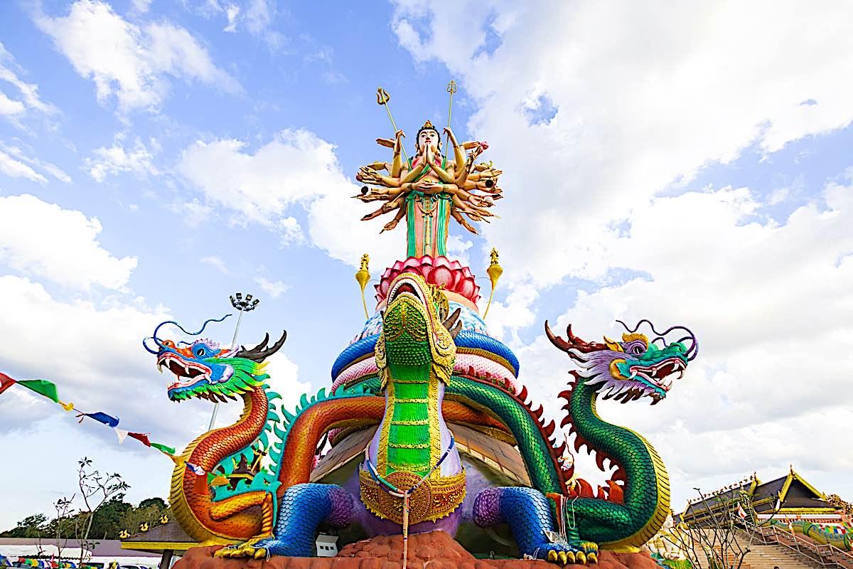 Buddha Weekly Ten Thousand Armed Guanyin Kuan Yin with dragon dreamstime xxl 64602068 Buddhism