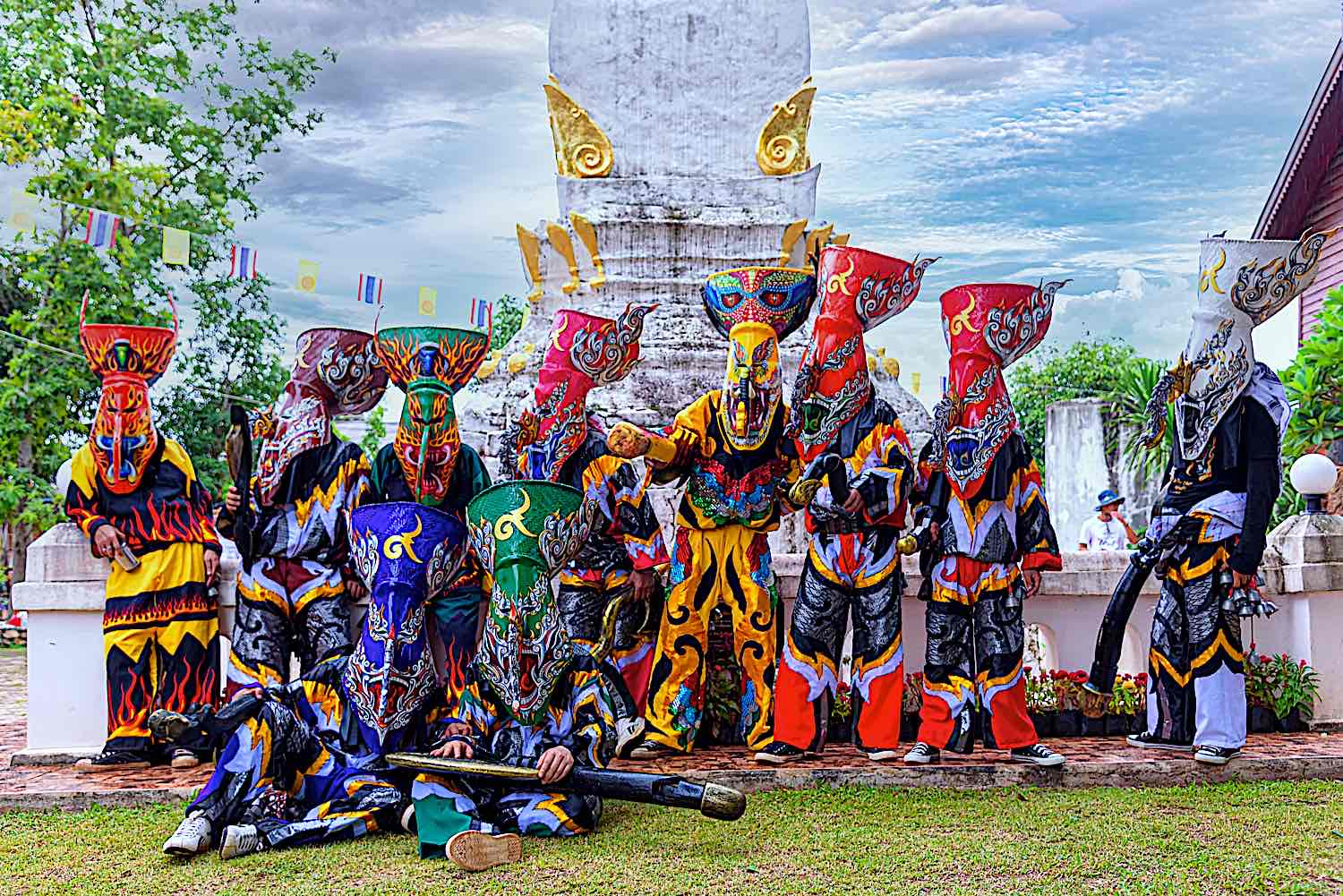 Unidentified men wear ghost costumes in Phi Ta Khon Festival is a masked procession celebrated by Buddhist at Dan Sai district, Indonesia.