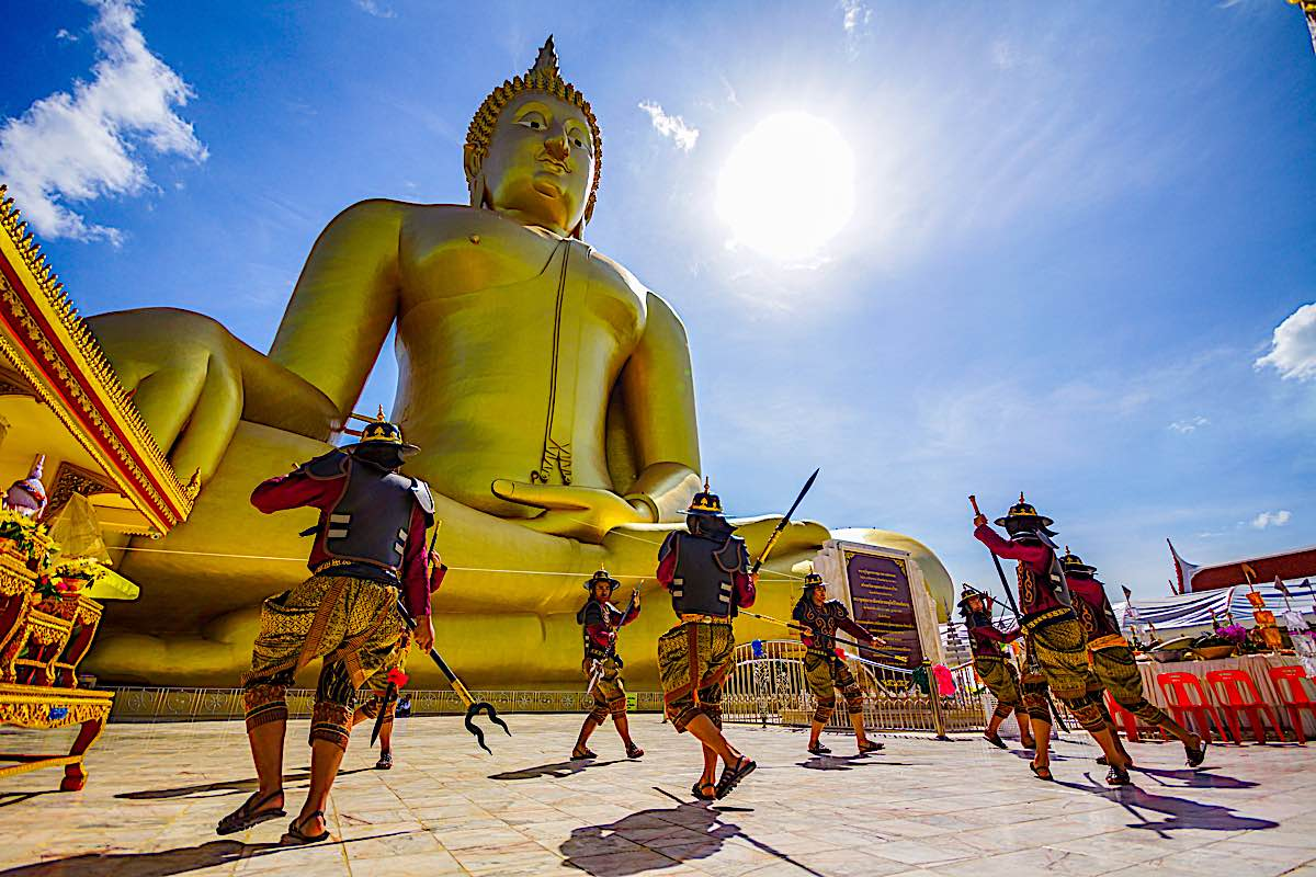 Buddha Weekly Warrior style in front of Buddha Statue at Wat Muang Buddhist Temple Buddhism
