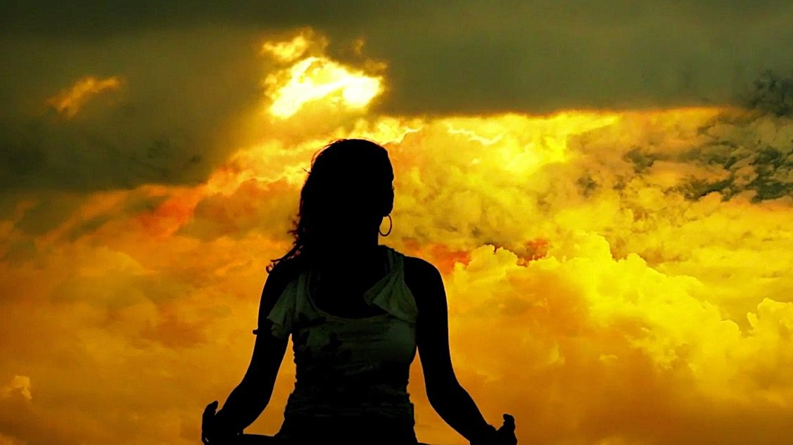 Buddha Weekly White Tara Videomeditating storm clouds symbolizing negative karmas Buddhism