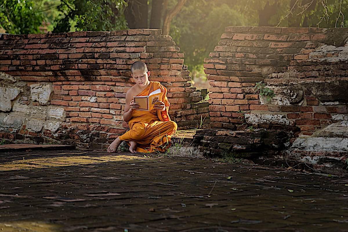 Buddha Weekly Young Buddhist Monk Reading book Buddhism