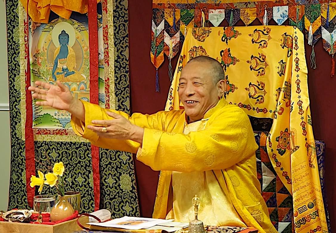 Buddha Weekly Zasep Rinpoche gesturing while teaching Medicine Buddha retreat Owen Sound Buddhism