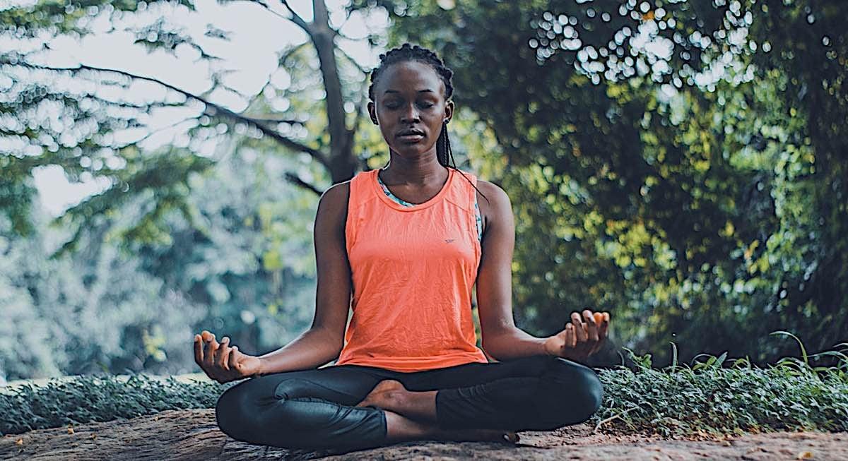 Buddha Weekly woman meditating Buddhism
