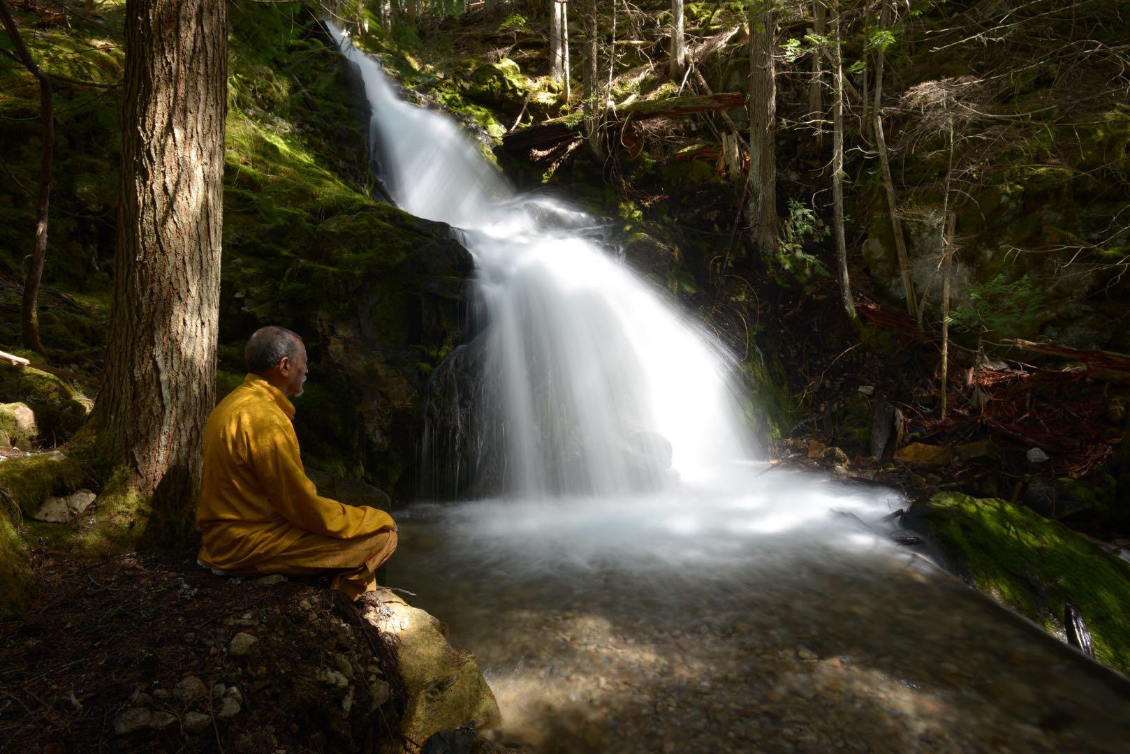 Rinpoche by a beautiful waterfall IMG 4786