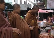 Practicing generosity creates positive karma. Here, a kind lay-Buddhist gives alms to three monks who, like the Buddha, eat only before noon and only from food given to them. Merit for good deeds is an intuitive concept in karma.