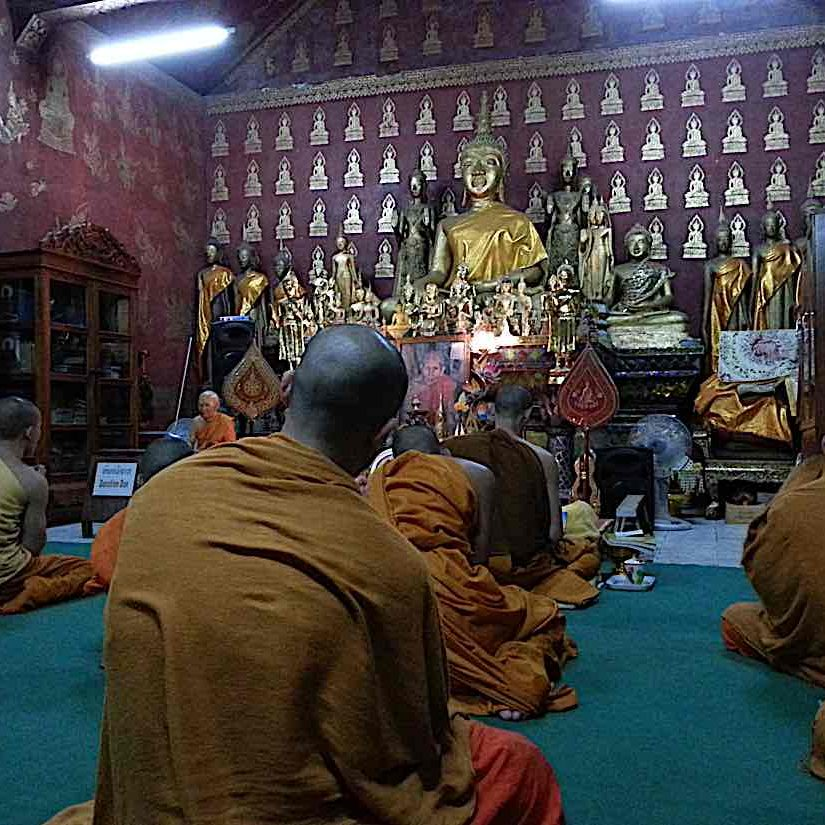 Dao chanting and meditating with monks in Laos.