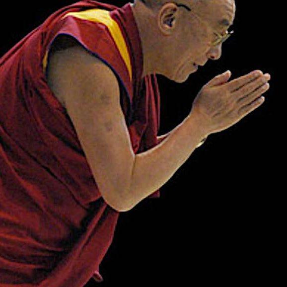 The Dalai Lama bows.