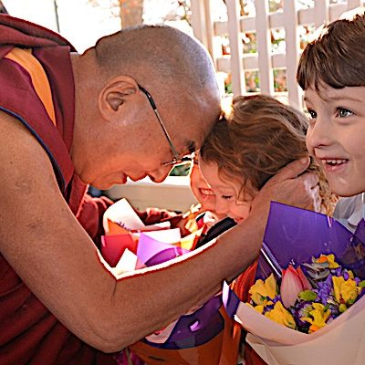 The Dalai Lama with children.