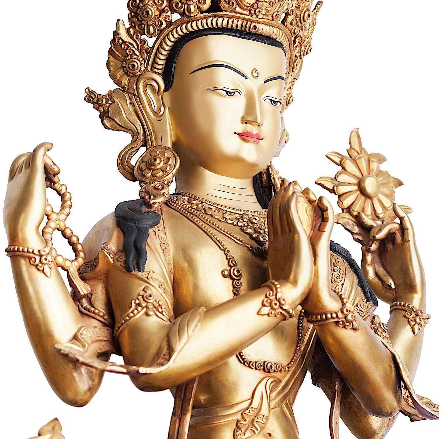 Four-Armed Chenrezig gilded statue.
