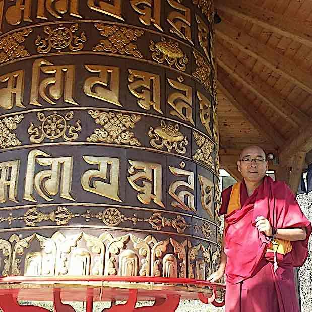 Geshe Sherab turns a giant prayer wheel with millions of mantras for the benefit of all sentient beings.