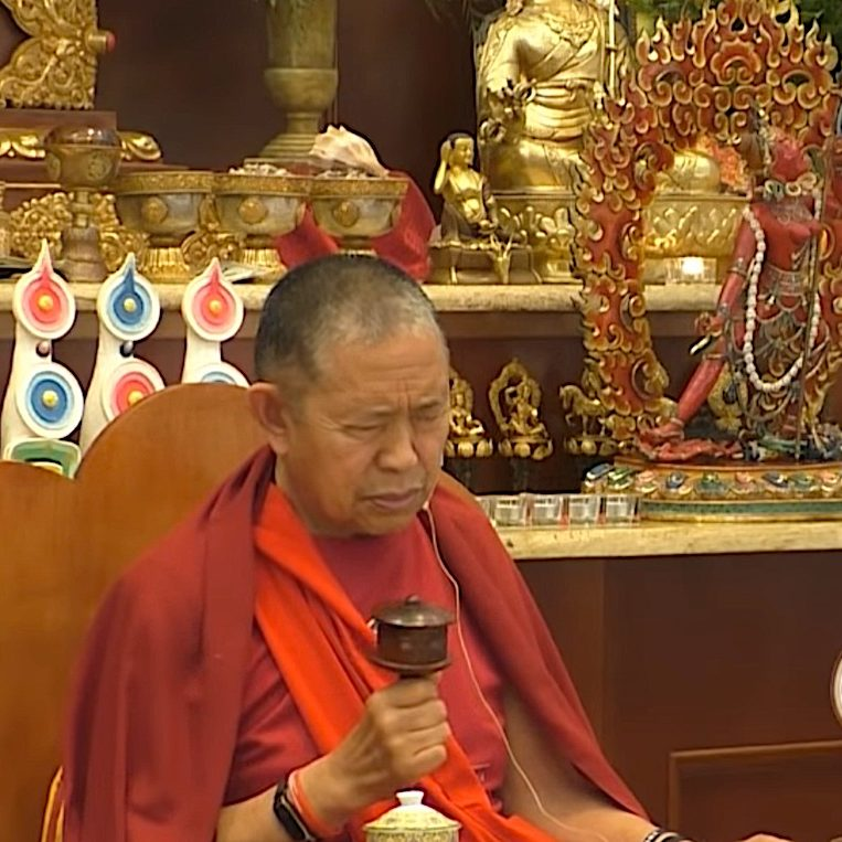 H.E. Garchen Rinpoche spinning a Dharma Wheel at a Higher Yogic teaching on Vajrayogini. Garchen Rinpoche is famous for compassionately spinning the wheel everywhere he can.