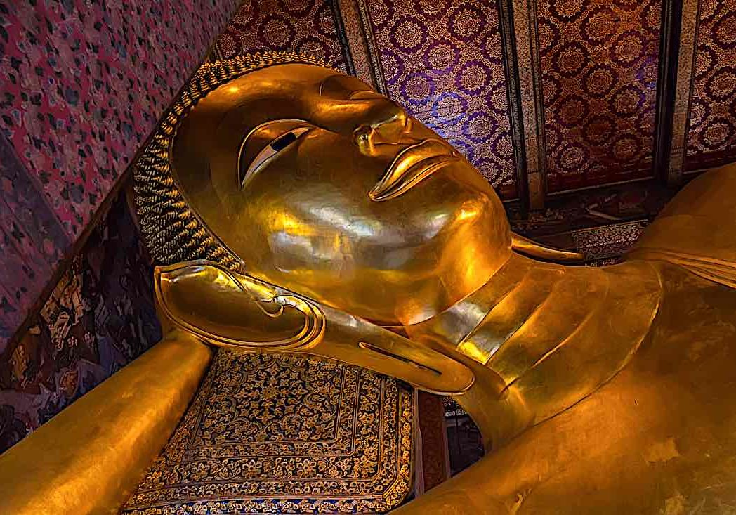 The famous Sleeping Buddha statues portray the paranirvana of Shakyamuni Buddha, the Blessed One.