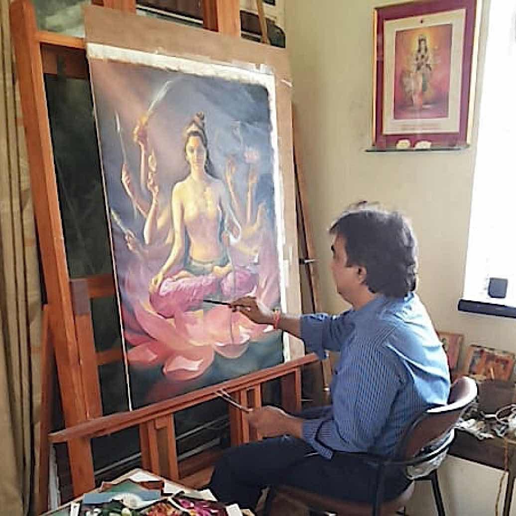 V. V. Sapar working on the one of the 21 Taras canvases, a commission from Dzongsar Rinpoche. This Tara is Tara 3 Golden Colour Tara Kanaka Vana Tara Ser Mo Serdok Chen Ge Drolma.