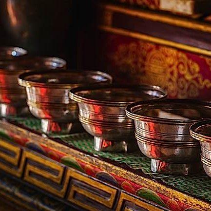 Offerings (Tibetan Water Offering Bowls) in Lamayuru gompa (Tibetan Buddhist monastery). Ladadkh, India.