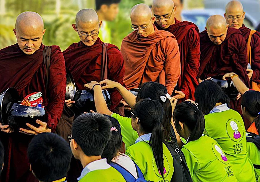 "Youth give ""dana"" to monastic Sangha, a meritorious action."