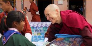 Emma Slade Buddhist Nun with Child in Bhutan